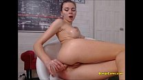 Skinny teen solo stuffs huge dildo in tight ass