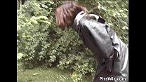 10932 Crazy slut pissing in public by PissWiz preview