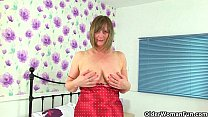 British milf April rips her tights for easy access Image