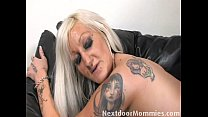 Tattooed MILF takes it in the ass