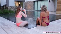 Two hot lesbians tribbing in the pool