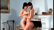 Amateur lesbian girls make out and caress in the living room preview image