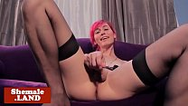 Wanking tgirl strokes her cock in stockings