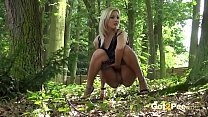 Blonde gushes piss while in the woods