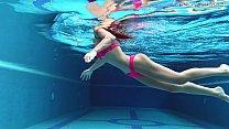 Image: Tiffany Tatum mastubates her sexy hairy pussy by the pool