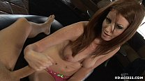 Attractive redhead strokes her kinky lover's stiff prick
