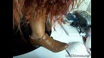 Busty redhead shows off her feet on webcam Preview