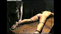 slave gets tortured whipped and burned image