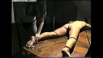 slave gets tortured whipped and burned صورة
