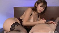 7642 Sexy tanned Mai Kuroki in bed playing with a horny guys cock making him cum preview
