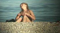 Cute nudist teen caught on cam Image