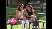 Cute girls play with a purple dildo