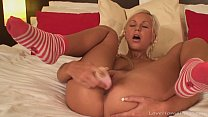 Teen leaves her socks on while masturbating
