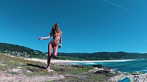 Hot beauty nudist teases you with her passionate and sexy body in a dance on the shores of the Atlantic Ocean