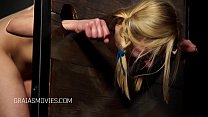Young blonde girl put in the stocks thumb