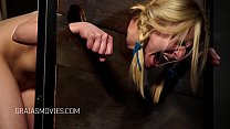 Young blonde girl put in the stocks Thumbnail