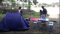 A girl fucked hard by two guys in a camping thumbnail