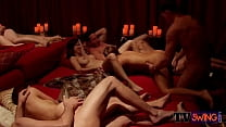 Dark couple foreplays with other horny swingers...