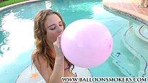 Busty teen blows to pop balloons outside in pool Vorschaubild