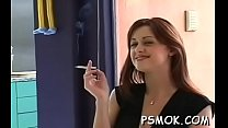 Lascivious cuttie in excited clothes smoking a cigarette