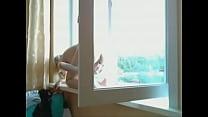 My beloved masturbates in the window for neighbours Vorschaubild