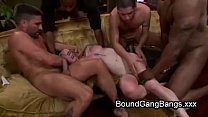 Hairy blonde tied up and orgy fucked outdoors