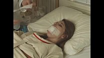Pretty brunette in Straitjacket taped mouth forced tied to bed hospital video