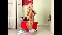 Glamour babe in white stockings and high heels Preview
