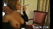 Playgirl smoking and giving a deepthroat at the same time