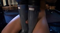 Slave worships 2 women in their hunter boots Thumbnail