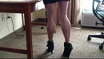 Penelope in ankle boots wiping the desk