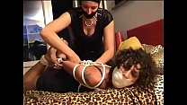 Kidnapper woman tied up by masked gimp