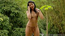 Carol Lopez takes off her bikini in the woods