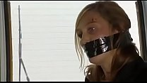 woman tape tied by evil woman