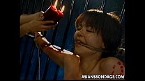 {you jzz} Skinny Japanese chick tied up and drenched in hot wax thumbnail