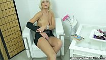Euro milf Roxana exposes her big tits and rubs her cunt thumbnail