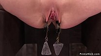 Brunette tormented with weighted clamps's Thumb