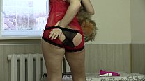 Girl with a nice figure in sexy lingerie undres...