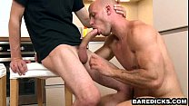 Two buff hunks with tattoos have anal sex