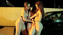 Lesbian sluts get horny in a car park and lick each other's pussy