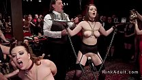 Blonde mistress leads slaves at bdsm party