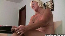 Office granny in pantyhose gives her old pussy a treat Image
