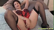 Seductive mature shemale stroking her cock