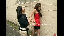 Female ties up an asian woman