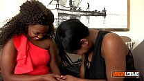 African lesbians eating pussy and fucking hard with strap-on image