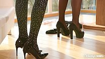Busty lesbians Florane Russell and Barbara Bieber foot play in pantyhose