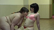 A fat lesbian sniffs panties and licks her girlfriend pussy. image