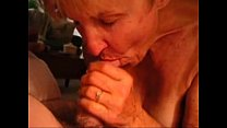 Mature lady sucking a cock