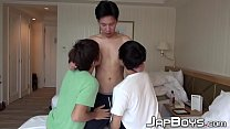Three young Japanese twinks sucking and kissing in threesome