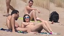 Sol fucks a guy in a beach surrounded by voyeurs thumb